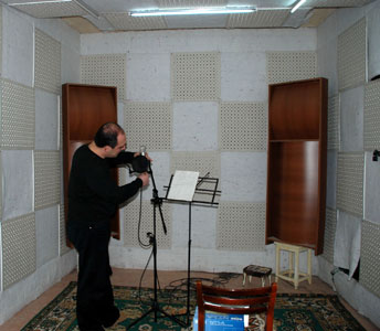 In recorging room.